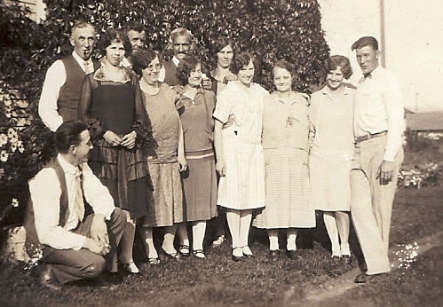 Old, sepia photograph of elders and their adult children