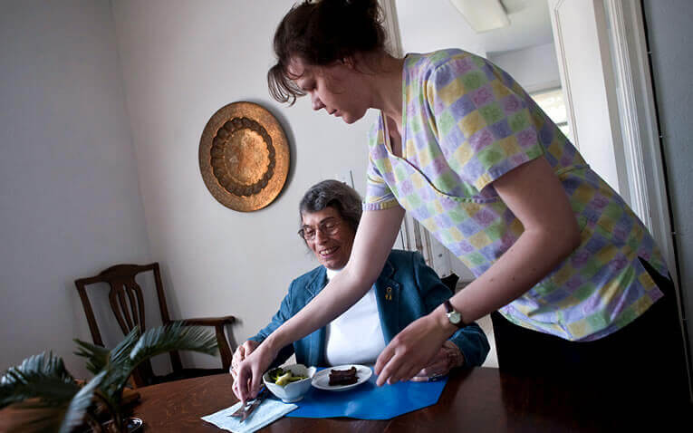 Caregiver helping senior with meal preparation in Spokane, Washington