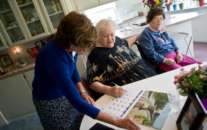 A caregiver helping an elderly woman with her calendar in Boise.