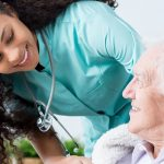 caregiver providing home health care for senior